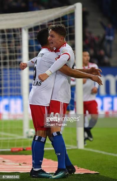 JannFiete Arpand Douglas Santos of Hamburg celebrate the first goal during the Bundesliga match between Hamburger SV and TSG 1899 Hoffenheim at...