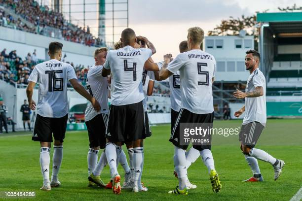 Janni Serra of Germany celebrates after scoring his team`s first goal with team mates during the U21 International friendly match between Germany and...