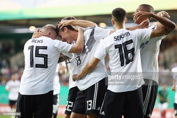 Janni Serra of Germany celebrates his team's first goal with team mates during the International Friendly match between Germany U21 and Mexico U21 at...