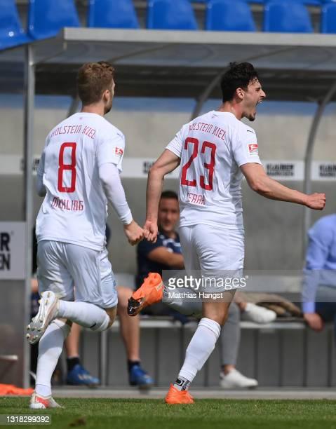 Janni Serra of Holstein Kiel celebrates after scoring their team's first goal during the Second Bundesliga match between Karlsruher SC and Holstein...
