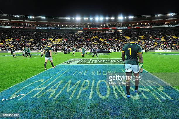 Jannie du Plessis and Tendai Mtawarira leave the field after The Rugby Championship match between the New Zealand All Blacks and the South Africa...