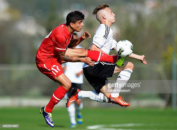Jannik Dehm of Germany is challenged by Berk Yildiz of Turkey during the U18 international friendly match between Turkey and Germany on November 18...