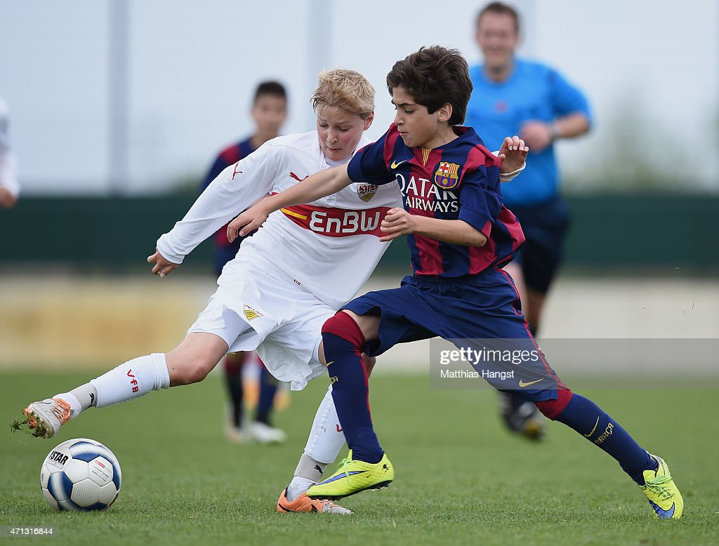 Jannik Friedrich (L) of Stuttgart is challenged by Matias Rafael Lacava (R) of Barcelona during the Final of the Santander Cup for U13 teams between FC Barcelona and VfB Stuttgart at Borussia Park Fohlenplatz on April 26, 2015 in Moenchengladbach, Germany.