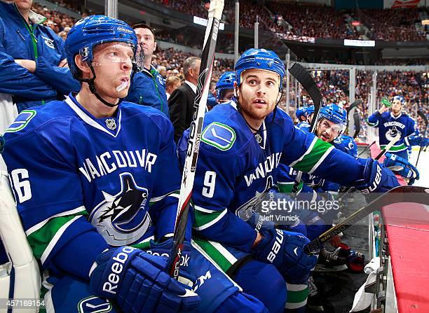 Jannik Hansen and Zack Kassian of the Vancouver Canucks look on from the bench during their NHL game against the Edmonton Oilers at Rogers Arena...