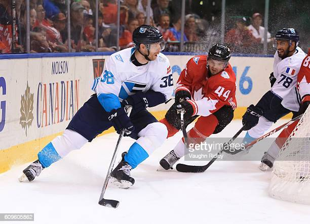 Jannik Hansen of Team Europe stickhandles the puck away from MarcEdouard Vlasic of Team Canada during the World Cup of Hockey 2016 at Air Canada...