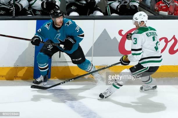 Jannik Hansen of the San Jose Sharks skates against John Klingberg of the Dallas Stars at SAP Center on February 18 2018 in San Jose California