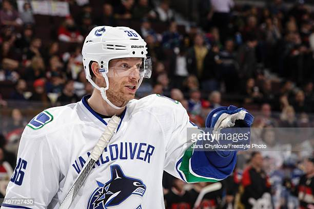 Jannik Hansen of the Vancouver Canucks points to a player during an NHL game against the Ottawa Senators at Canadian Tire Centre on November 12 2015...