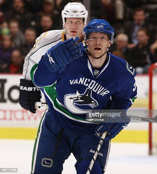 Jannik Hansen of the Vancouver Canucks skates to the bench during their game against the Nashville Predators at General Motors Place on January 11...