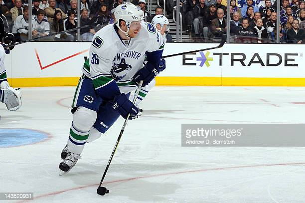 Jannik Hansen of the Vancouver Canucks skates with the puck against the Los Angeles Kings in Game Four of the Western Conference Quarterfinals during...