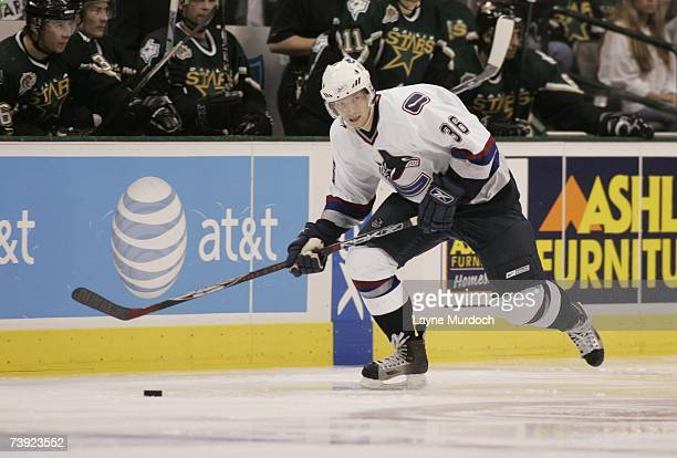 Jannik Hansen of the Vancouver Canucks skates with the puck against the Dallas Stars during game three of the 2007 NHL Western Conference...