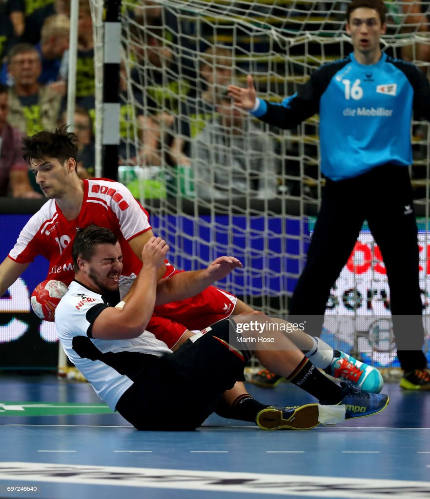 Jannik Kohlbacher #48 of Germany challenges Dimitrij Kuettel of Switzerland during the 2018 EHF European Championship Qualifier between Germany and Switzerland at OVB-Arena on June 18, 2017 in Bremen, Germany.