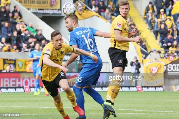 Jannik Mueller of Dynamo Dresden and Lukas Hinterseer of VfL Bochum 1848 battle for the ball during the second Bundesliga match between Dynamo...