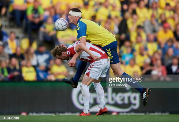 Jannik Pohl of AaB Aalborg and Benedikt Rocker of Brondby IF compete for the ball during the Danish Alka Superliga match between Brondby IF and AaB...