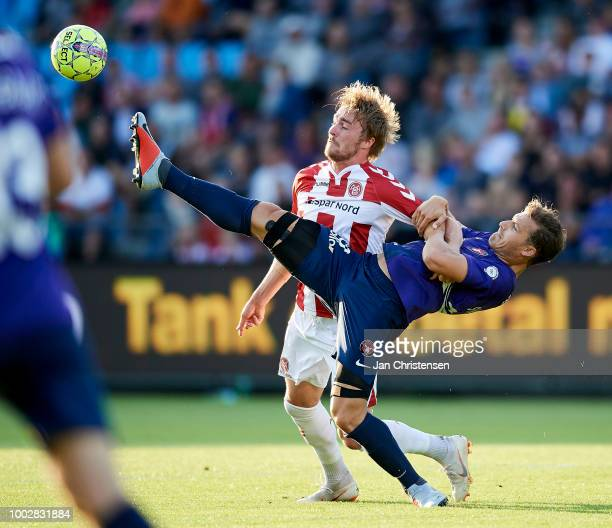 Jannik Pohl of AaB Aalborg and Erik Sviatchenko of FC Midtjylland compete for the ball during the Danish Superliga match between AaB Aalborg and FC...