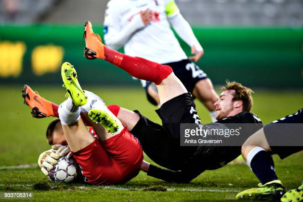 Jannik Pohl of AaB Aalborg and Goalkeeper Aleksandar Jovanovic of AGF Aarhus in action during the Danish Alka Superliga match between AGF Aarhus and...