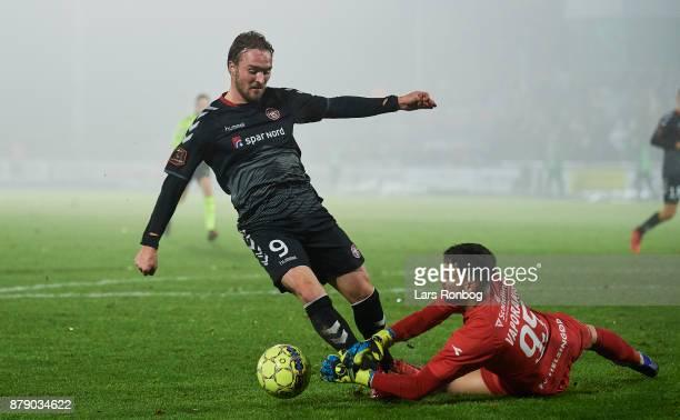 Jannik Pohl of AaB Aalborg and Goalkeeper Aris Vaporakis of FC Helsingor compete for the ball during the Danish Alka Superliga match between FC...