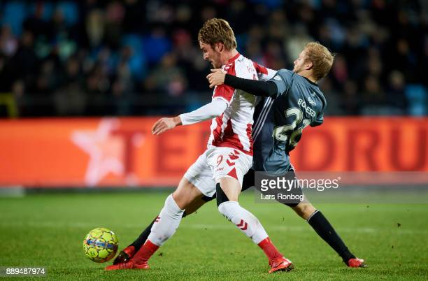 Jannik Pohl of AaB Aalborg and Nicolai Boilesen of FC Copenhagen compete for the ball during the Danish Alka Superliga match between AaB Aalborg and...