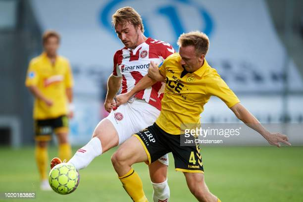 Jannik Pohl of AaB Aalborg and Soren Reese of AC Horsens compete for the ball during the Danish Superliga match between AC Horsens and AaB Aalborg at...