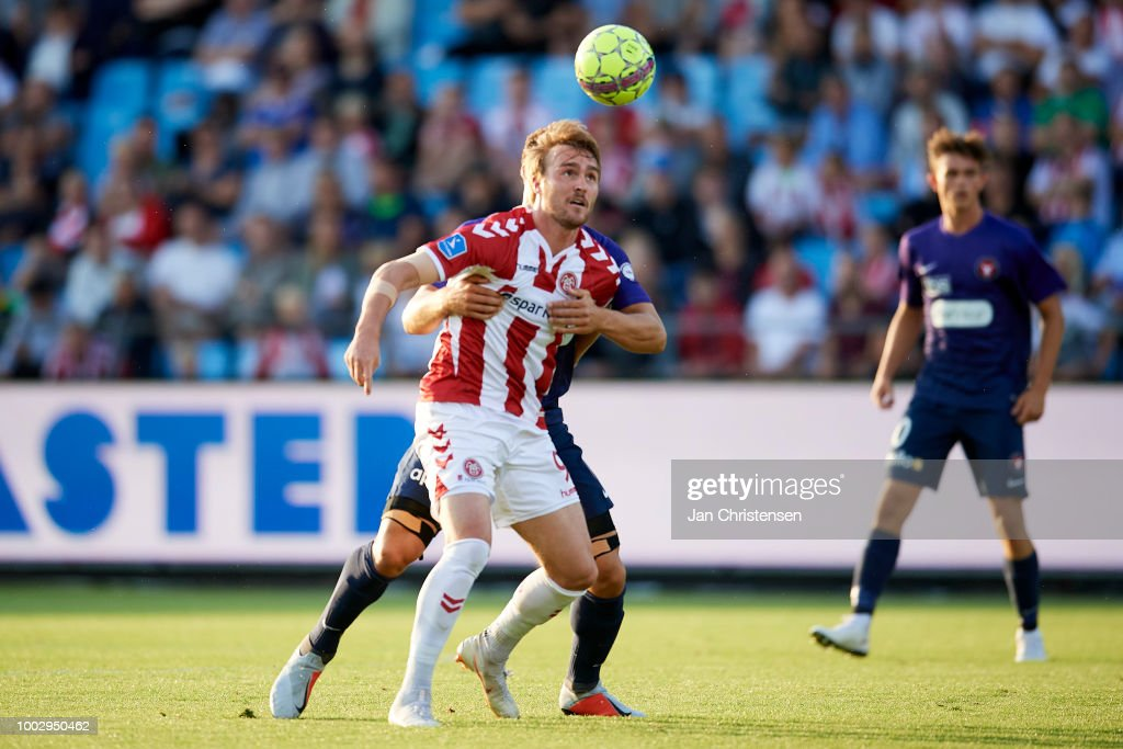 Jannik Pohl of AaB Aalborg compete for the ball during the Danish Superliga match between AaB Aalborg and FC Midtjylland at Aalborg Portland Park on July 20, 2018 in Aalborg, Denmark.