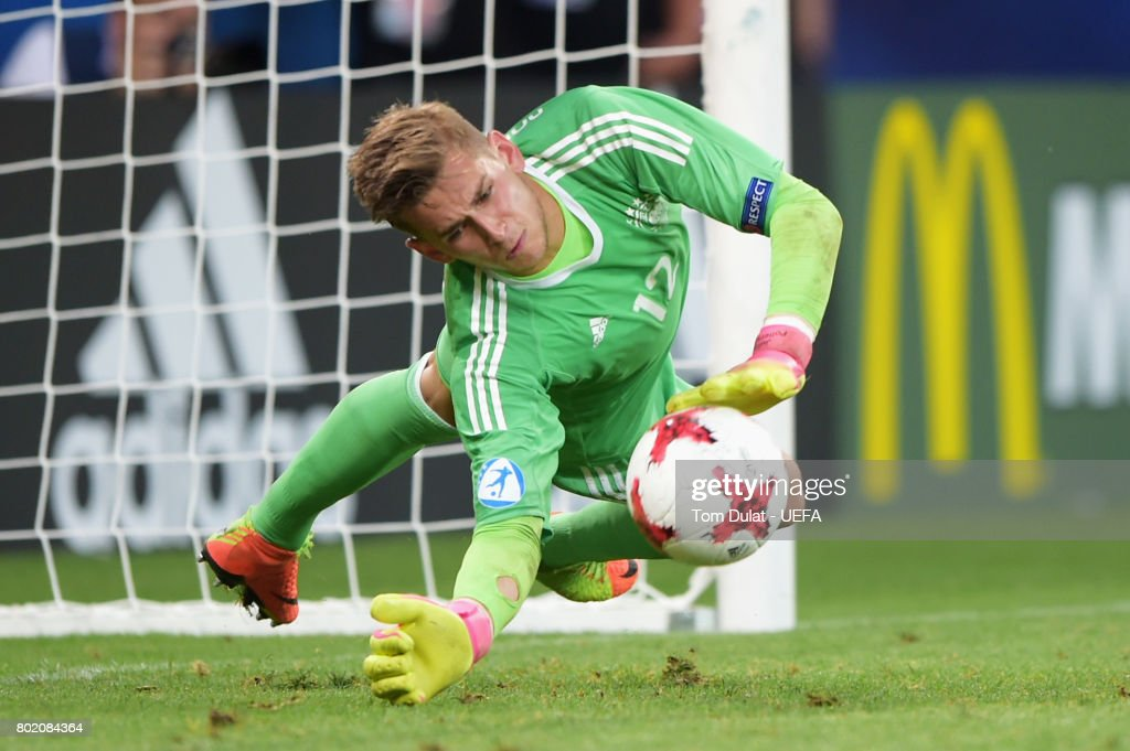 Jannik Pollersbeck of Germany saves England fifth penalty taken by Nathan Redmond of England to win the penalty shoot out during the UEFA European Under-21 Championship Semi Final match between England and Germany at Tychy Stadium on June 27, 2017 in Tychy, Poland.
