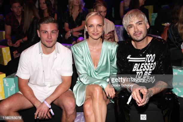 Jannik Schuemann, Janin Ullmann and Bill Kaulitz attend the opening show of the AYFW - About You Fashion Week at ewerk on July 05, 2019 in Berlin,...