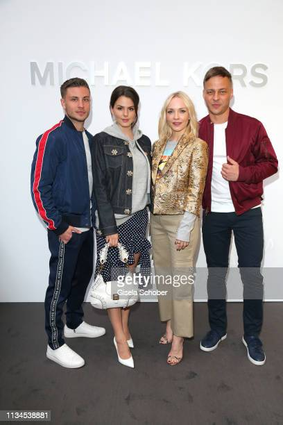 Jannik Schuemann Ruby OFee and Janin Ullmann and Tom Wlaschiha attend the opening of the Michael Kors store on April 2 2019 in Munich Germany