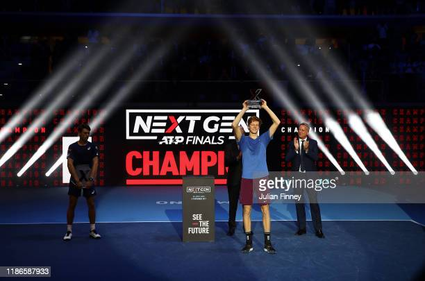 Jannik Sinner of Italy celebrates with the winners trophy after defeating Alex de Minaur of Australia in the final during Day Five of the Next Gen...
