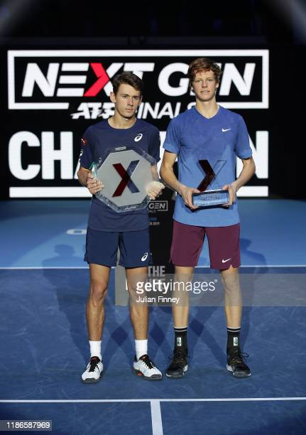 Jannik Sinner of Italy celebrates with the winners trophy next to runner up Alex de Minaur of Australia in the final during Day Five of the Next Gen...