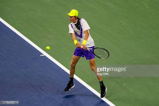 Jannik Sinner of Italy hits a backhand against Stan Wawrinka of Switzerland in the first round of the US Open at the USTA Billie Jean King National...