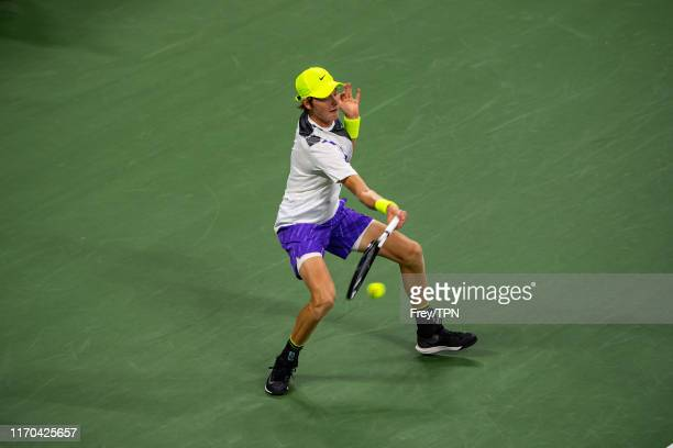 Jannik Sinner of Italy hits a forehand against Stan Wawrinka of Switzerland in the first round of the US Open at the USTA Billie Jean King National...