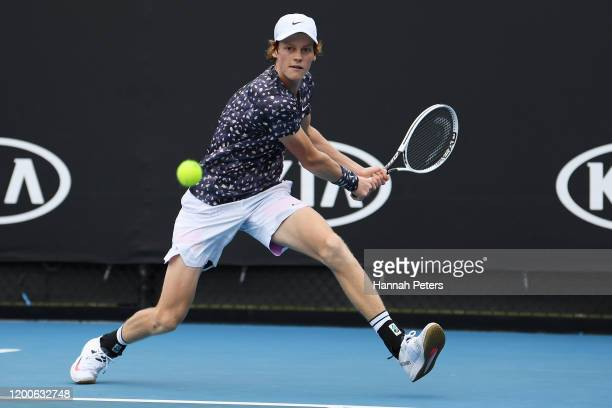 Jannik Sinner of Italy plays a backhand during his Men's Singles first round match against Max Purcell of Australia on day one of the 2020 Australian...