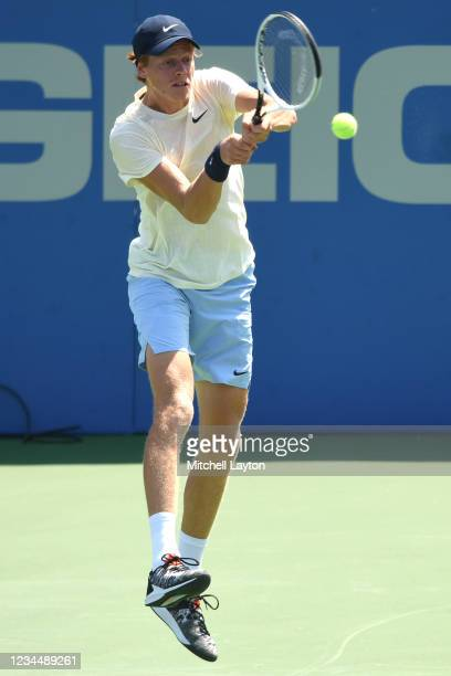 Jannik Sinner of Italy returns a shot during a match against Sebastian Korda of the United States on Day 6 during the Citi Open at Rock Creek Tennis...