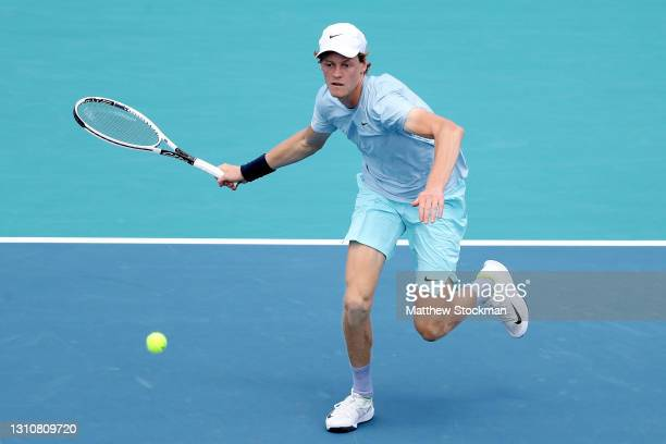 Jannik Sinner of Italy returns a shot to Hubert Hurkacz of Poland during the final of the Miami Open at Hard Rock Stadium on April 04, 2021 in Miami...