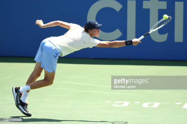 Jannik Sinner of Italy tries to return a shot during a match against Sebastian Korda of the United States on Day 6 during the Citi Open at Rock Creek...