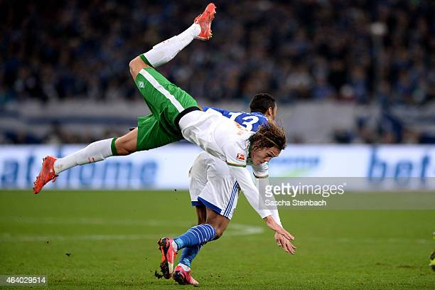Jannik Verstergaard of Bremen dives to the ground during the Bundesliga match between FC Schalke 04 and SV Werder Bremen at Veltins Arena on February...