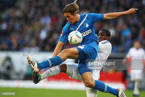 Jannik Vestergaard 8front) of Hoffenheim is challenged by Jefferson Farfan of Schalke during the Bundesliga match between 1899 Hoffenheim and FC...