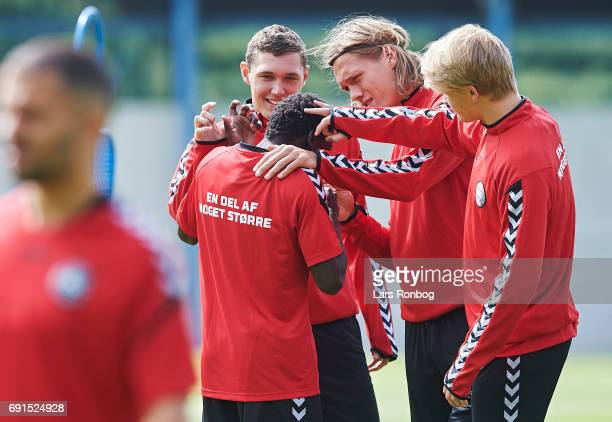 Jannik Vestergaard and Andreas Christensen flips Phone Sisto during the Denmark training session at Brondby Stadion on June 2 2017 in Brondby Denmark