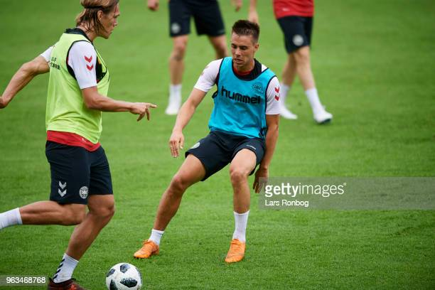 Jannik Vestergaard and Jonas Knudsen of Denmark compete for the ball during the Denmark training session Helsingor Stadion on May 28 2018 in...