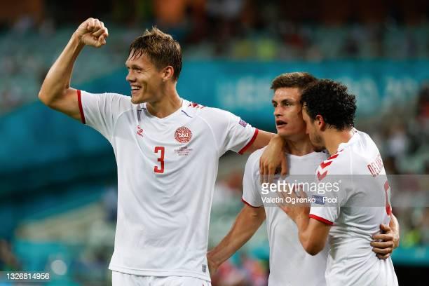 Jannik Vestergaard, Joakim Maehle and Thomas Delaney of Denmark celebrate their side's second goal scored by team mate Kasper Dolberg during the UEFA...