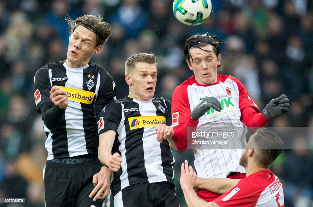 Jannik Vestergaard, Matthias Ginter of Borussia Moenchengladbach and Michael Gregoritsch of FC Augsburg battle for the ball during the Bundesliga match between Borussia Moenchengladbach and FC Augsburg at Borussia-Park on January 20, 2018 in Moenchengladbach, Germany.