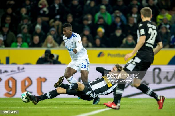 Jannik Vestergaard of Borussia Moenchengladbach and Breel Embolo of FC Schalke 04 battle for the ball during the Bundesliga match between Borussia...