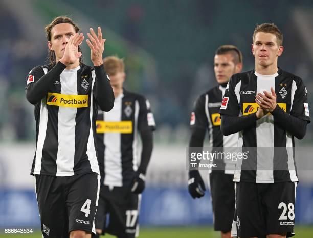 Jannik Vestergaard of Borussia Moenchengladbach and Oscar Wendt of Borussia Moenchengladbach and Raul Bobadilla of Borussia Moenchengladbach and...