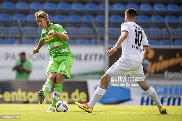 Jannik Vestergaard of Borussia Moenchengladbach challenges Philipp Foerster of SV Waldhof Mannheim during the friendly match between SV Waldhof...