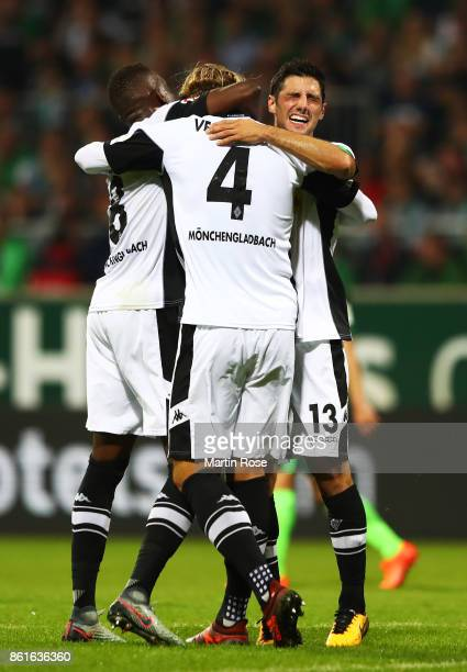 Jannik Vestergaard of Borussia Moenchengladbach is congratulated by Lars Stindl of Borussia Moenchengladbach after scoring the second goal during the...