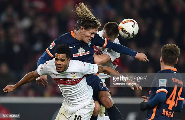 Jannik Vestergaard of Bremen jumps for a header with Daniel Didavi of Stuttgart and Toni Sunjic of Stuttgart during the Bundesliga match between VfB...