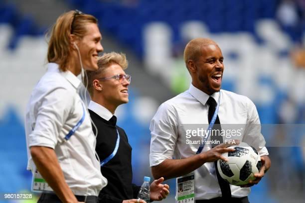 Jannik Vestergaard of Denmark Viktor Fischer of Denmark and Mathias Jorgensen of Denmark speak during a pitch inspection prior to the 2018 FIFA World...