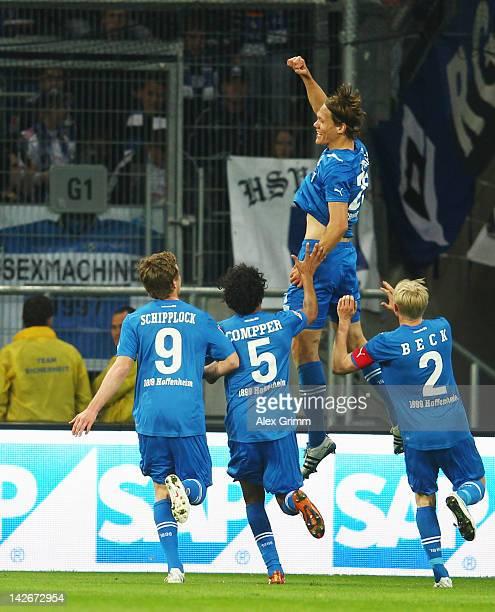 Jannik Vestergaard of Hoffenheim celebrates his team's first goal with team mates during the Bundesliga match between 1899 Hoffenheim and Hamburger...