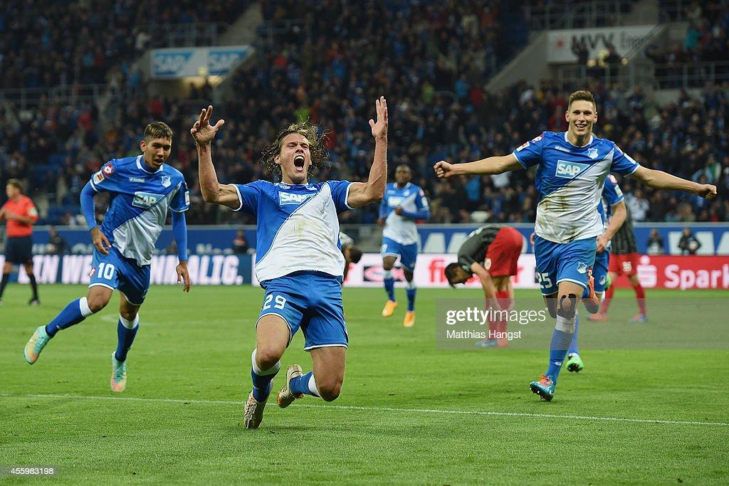 Jannik Vestergaard (C) of Hoffenheim celebrates with his team-mates after scoring his team's third goal during the Bundesliga match between TSG 1899 Hoffenheim and SC Freiburg at Wirsol Rhein-Neckar-Arena on September 23, 2014 in Sinsheim, Germany.