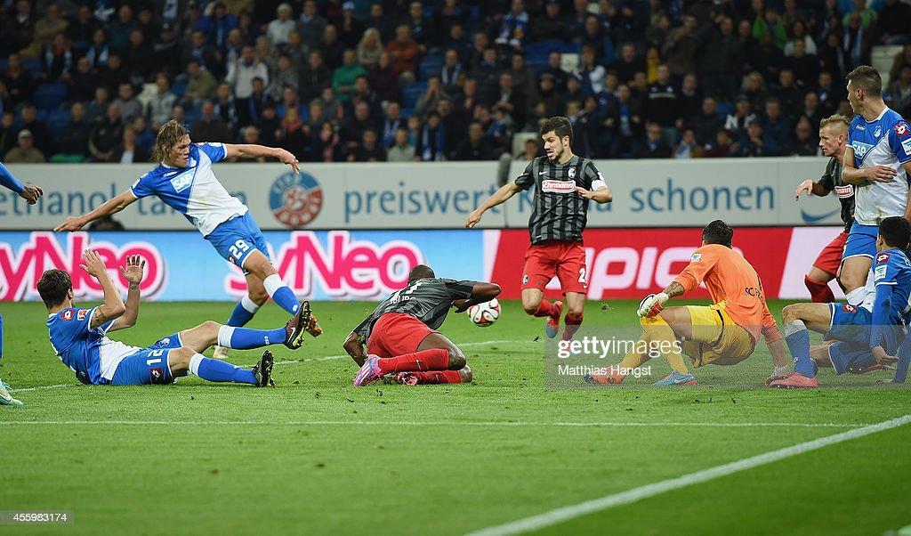 Jannik Vestergaard (2 R) of Hoffenheim scores his team's third goal during the Bundesliga match between TSG 1899 Hoffenheim and SC Freiburg at Wirsol Rhein-Neckar-Arena on September 23, 2014 in Sinsheim, Germany.