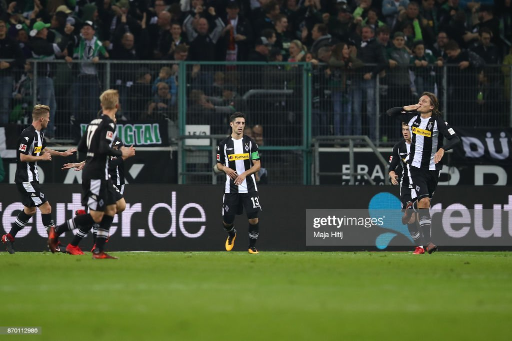 Jannik Vestergaard of Moenchengladbach (r) celebrates after he scored a goal to make it 1:1 during the Bundesliga match between Borussia Moenchengladbach and 1. FSV Mainz 05 at Borussia-Park on November 4, 2017 in Moenchengladbach, Germany.